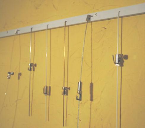 Dise o de interiores con cuadros en capital rieles j - Sistemas para colgar cuadros ...
